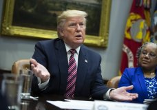 Barb Smith, President, Journey Steel, Inc., right, listens President Donald Trump speaks during a small business roundtable in the Roosevelt Room of the White House, Friday, Dec. 6, 2019, in Washington. (AP Photo/ Evan Vucci)