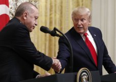 FILE - In this Nov. 13, 2019 file photo, President Donald Trump shakes hands with Turkish President Recep Tayyip Erdogan during a news conference in the East Room of the White House in Washington. The State Department says recent congressional action to recognize the Armenian genocide does not reflect Trump administration policy. That statement is likely to pleaseErdogan. The Senate voted unanimously last week to recognize the mass killings of more than a million Armenians by Ottoman Turks a century ago as a genocide. (AP Photo/Patrick Semansky)