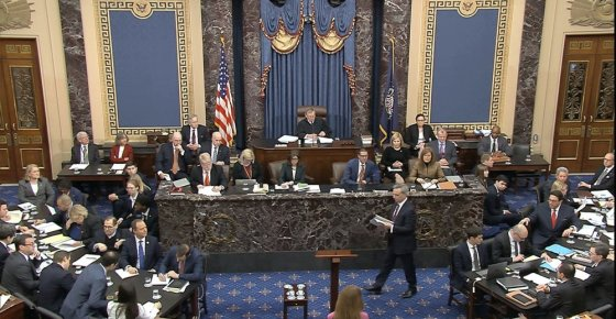 In this image from video, White House counsel Pat Cipollone walks to the podium to begin the presentation of the case by the defense during the impeachment trial against President Donald Trump in the Senate at the U.S. Capitol in Washington, Saturday, Jan. 25, 2020. (Senate Television via AP)