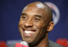 FILE - In this Nov. 26, 2013 file photo Los Angeles Lakers guard Kobe Bryant smiles during a media availability before an NBA basketball game against the Washington Wizards in Washington. The Retired NBA superstar has died in helicopter crash in Southern California, Sunday, Jan. 26, 2020. (AP Photo/Alex Brandon)