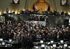 "Iranian lawmakers chant slogans as some of them hold posters of Gen. Qassem Soleimani, who was killed in Iraq in a U.S. drone attack, in an open session of parliament, in Tehran, Iran, Tuesday, Jan. 7, 2020. Iran's parliament has passed an urgent bill declaring the U.S. military's command at the Pentagon in Washington and those acting on its behalf ""terrorists,"" subject to Iranian sanctions. (AP Photo/Vahid Salemi)"