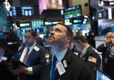 Stock trader Frank Masiello works at the New York Stock Exchange, Tuesday, Feb. 4, 2020. Stocks are opening broadly higher on Wall Street, following gains overseas. (AP Photo/Mark Lennihan)