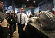 Democratic presidential candidate former South Bend, Ind., Mayor Pete Buttigieg arrives at Community Oven Pizza for a campaign event, Tuesday, Feb. 4, 2020, in Hampton, N.H. (AP Photo/Elise Amendola)