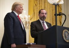President Donald Trump listens to Department of Health and Human Services Secretary Alex Azar, speaks about coronavirus during an Black History Month reception in the East Room of the White House, Thursday, Feb. 27, 2020, in Washington. (AP Photo/Manuel Balce Ceneta)