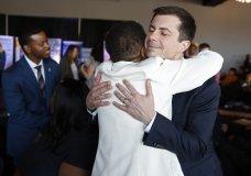 Democratic presidential candidate former South Bend Mayor Pete Buttigieg embraces Hannah Brown at the Nevada Black Legislative Caucus Black History Awards brunch Sunday, Feb. 16, 2020, in Las Vegas. (AP Photo/John Locher)
