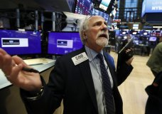 Trader peter Tuchman works on the floor of the New York Stock Exchange, Monday, March 9, 2020. The Dow Jones Industrial Average plummeted 1,500 points, or 6%, following similar drops in Europe after a fight among major crude-producing countries jolted investors already on edge about the widening fallout from the outbreak of the new coronavirus. (AP Photo/Richard Drew)