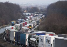 Trucks are jammed on the motorway A4 near Bautzen, Germany, Tuesday, March 17, 2020. Because of the controls at the border with Poland, a traffic jam formed on the Autobahn 4 between Dresden and Goerlitz, which, according to police, had grown to a length of 40 kilometers by noon. For most people, the new coronavirus causes only mild or moderate symptoms, such as fever and cough. For some, especially older adults and people with existing health problems, it can cause more severe illness, including pneumonia. (Robert Michael/dpa via AP)