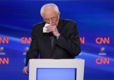 Sen. Bernie Sanders, I-Vt., wipes his nose during the Democratic presidential primary debate at CNN Studios, Sunday, March 15, 2020, in Washington. (AP Photo/Evan Vucci)