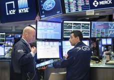 This photo provided by the New York Stock Exchange shows trader Patrick Casey, left, and specialist Peter Mazza as they work on the trading floor on Friday, March 20, 2020. Stocks turned lower Friday after New York became the latest major state to mandate nearly all workers stay home to limit the spread of the new coronavirus. (Nicole Pereira/NYSE via AP)