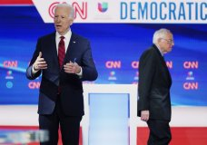 In this Sunday, March 15, 2020, photo, former Vice President Joe Biden prepares for a Democratic presidential primary debate with Sen. Bernie Sanders, I-Vt., at CNN Studios in Washington. Biden's status as Democratic presidential nominee-in-waiting means the party will choose another man for an office never held by a woman. But he's running with plenty of women behind him, including a yet-to-be-named vice presidential running mate. (AP Photo/Evan Vucci)