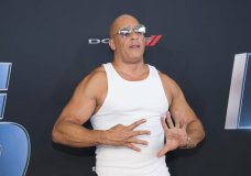 """FILE - In this Jan. 31, 2020 file photo, actor Vin Diesel holds up nine fingers as he attends the the Road to """"Fast & Furious 9"""" Concert in Miami, Fla. Universal Pictures is moving back the release of the ninth Fast and Furious film by a year amid the coronavirus outbreak. The studio on Thursday said that """"F9"""" will open on April 2, 2021. It had been previously scheduled to open on May 22, 2020. The vast majority of people recover from the new virus, but for some, it can cause more severe illness, including pneumonia. (Photo by Scott Roth/Invision/AP, File)"""