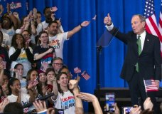 Former Democratic presidential candidate Mike Bloomberg gestures to supporters as he announces the suspension of his campaign and his endorsement of former Vice President Joe Biden for president in New York Wednesday , March 4, 2020. (AP Photo/Eduardo Munoz Alvarez)