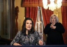 FILE - In this April 13, 2020 file photo, provided by the Michigan Office of the Governor, Michigan Gov. Gretchen Whitmer addresses the state during a speech in Lansing, Mich. Seven Midwestern governors announced Thursday, April 16, 2020 that they will coordinate on reopening their state economies amid the coronavirus pandemic, after similar pacts were made in the Northeast and on the West Coast. The latest agreement includes Illinois, Ohio, Michigan, Indiana, Wisconsin, Minnesota and Kentucky.(Michigan Office of the Governor via AP, Pool)