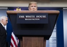 President Donald Trump speaks about the coronavirus, with Vice President Mike Pence nearby, in the James Brady Press Briefing Room of the White House, Friday, April 24, 2020, in Washington. (AP Photo/Alex Brandon)