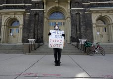 Jim Carpenter protests Tuesday's scheduled election amid the coronavirus pandemic Monday April 6, 2020, in downtown Milwaukee. The new coronavirus causes mild or moderate symptoms for most people, but for some, especially older adults and people with existing health problems, it can cause more severe illness or death. (AP Photo/Morry Gash)