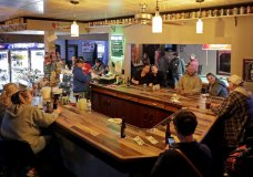 Club Ritz opens to patrons following the Wisconsin Supreme Court's decision to strike down Gov. Tony Evers' safer-at-home order amid the coronavirus pandemic, Wednesday, May 13, 2020, in Kaukauna, Wis. (William Glasheen/The Post-Crescent via AP)