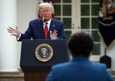 FILE - This March 29, 2020 file photo shows President Donald Trump answering a question from PBS reporter Yamiche Alcindor during a coronavirus task force briefing in the Rose Garden of the White House in Washington. Reporters Alcindor, Weijia Jiang and Kaitlan Collins have faced hostility from Trump at news conferences with stoicism. Their experiences illustrate the challenge of working at a White House with near-daily accessibility to a president who considers the press an enemy. (AP Photo/Patrick Semansky, FIle)