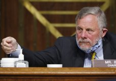 Chairman Richard Burr, R-N.C., reaches for hand sanitizer at a Senate Intelligence Committee nomination hearing for Rep. John Ratcliffe, R-Texas, on Capitol Hill in Washington, Tuesday, May. 5, 2020. The panel is considering Ratcliffe's nomination for director of national intelligence. (AP Photo/Andrew Harnik, Pool)