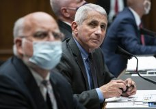 Dr. Robert Redfield, director of the Centers for Disease Control and Prevention, left, Director of the National Institute of Allergy and Infectious Diseases Dr. Anthony Fauci, second from left, listen during a House Committee on Energy and Commerce on the Trump administration's response to the COVID-19 pandemic on Capitol Hill in Washington on Tuesday, June 23, 2020. (Sarah Silbiger/Pool via AP)