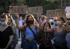 People gather in Barcelona, Spain, Thursday, June 4, 2020, during a demonstration over the death of George Floyd, a black man who died after being restrained by Minneapolis police officers on May 25. (AP Photo/Emilio Morenatti)