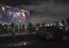"FILE - In this March 19, 2020 file photo, viewers in a parked car watch the animated film ""Onward"" at the Paramount Drive-In Theatres, in Paramount, Calif. ""Jaws,"" ""Black Panther"" and ""Back to the Future"" are just a few of the modern popcorn classics coming to the drive-in this summer. Tribeca Enterprises, IMAX and AT&T on Monday announced the initial lineup for its summer series of films, comedy and football offerings running every weekend from July 2 through Aug. 2 in cities like Los Angeles, New York, Dallas, Minneapolis, Atlanta and Seattle. (AP Photo/Chris Pizzello, File)"