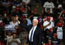 Vice President Mike Pence waves to the crowd during a campaign rally in Tulsa, Okla., Saturday, June 20, 2020. (AP Photo/Sue Ogrocki)