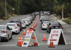 Motorists line up at a coronavirus testing site at Dodger Stadium Monday, June 29, 2020, in Los Angeles. (AP Photo/Marcio Jose Sanchez)