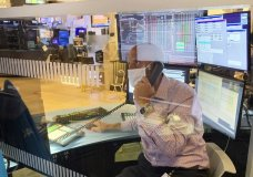 Meric Greenbaum, with IMC, is seen behind one of the newly installed plastic barriers at trading posts on the floor of the New York Stock Exchange, as specialists returned to the partially reopened trading floor, Thursday, June 18, 2020. Wall Street is dipping modestly in early trading on Thursday as rising infection levels of the coronavirus in hotspots around the world get markets more cautious. (AP Photo)