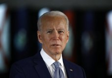 """FILE - In this March 10, 2020, file photo Democratic presidential candidate former Vice President Joe Biden speaks to members of the press at the National Constitution Center in Philadelphia. Biden said Friday, May 29, that the """"open wound"""" of systemic racism was behind the police killing of a handcuffed black man in Minnesota, and swiped at President Donald Trump for inciting violence, without mentioning him by name. """"We are a country with an open wound. None of us can turn away,"""" Biden in a brief online address. (AP Photo/Matt Rourke, File)"""