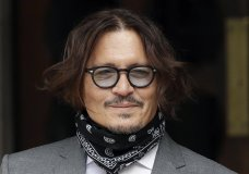 "American actor Johnny Depp poses for the media as he arrives at the High Court in London, Monday, July 13, 2020. Depp is expected to wrap up his evidence at his libel trial against a tabloid newspaper that accused him of abusing ex-wife Amber Heard. The Hollywood star is suing News Group Newspapers, publisher of The Sun, and the paper's executive editor, Dan Wootton, over an April 2018 article that called him a ""wife-beater."" (AP Photo/Matt Dunham)"