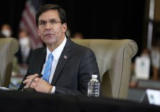 FILE - In this July 10, 2020, file photo Defense Secretary Mark Esper speaks during a briefing on counternarcotics operations at U.S. Southern Command in Doral, Fla. Defense leaders are weighing a new policy that would bar the display of the Confederate flag at department facilities without actually mentioning its name, several U.S. officials said Thursday, July 16. Esper discussed the new plan with senior leaders this week. (AP Photo/Evan Vucci, File)