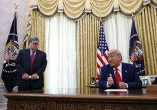 President Donald Trump speaks alongside Attorney General William Barr during a law enforcement briefing on the MS-13 gang in the Oval Office of the White House, Wednesday, July 15, 2020, in Washington. (AP Photo/Patrick Semansky)