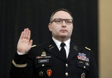 "FILE - In this Nov. 19, 2019, file photo National Security Council aide Lt. Col. Alexander Vindman is sworn in to testify before the House Intelligence Committee on Capitol Hill in Washington. Vindman, who played a central role in President Donald Trump's impeachment case, announced his retirement from the army July 7, 2020, in a scathing statement that accused the president of running a ""campaign of bullying, intimidation, and retaliation.""(AP Photo/Andrew Harnik, File)"