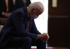 "FILE - In this June 1, 2020, file photo, Democratic presidential candidate, former Vice President Joe Biden bows his head in prayer as he visits Bethel AME Church in Wilmington, Del. Photos in a campaign ad for President Donald Trump show that former Vice President Biden is ""alone, hiding, diminished."" The ad blurs details that show Biden is praying in a church. The ad was tweeted by @TeamTrump on Wednesday, Aug. 5, 2020. (AP Photo/Andrew Harnik, File)"