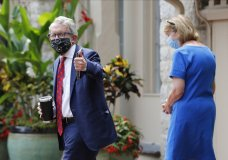Ohio Governor Mike DeWine, left, and his wife Fran, walk into their residence after he tested positive for COVID-19 earlier in the day Thursday, Aug. 6, 2020, in Bexley, Ohio. (AP Photo/Jay LaPrete)