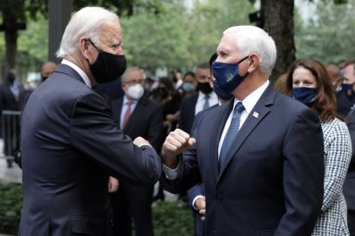 Democratic presidential candidate Joe Biden greets Vice President Mike Pence at the National September 11 Memorial & Museum in New York (Amr Alfiky/The New York Times via AP, Pool)