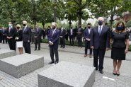 From left, New York Gov. Andrew Cuomo, Jill Biden with her husband Democratic presidential candidate and former Vice President Joe Biden, former NYC Mayor Mike Bloomberg, Vice President Mike Pence and his wife Karen, observe a moment of silence on Friday, Sept. 11, 2020, in New York. The names of nearly 3,000 victims of the Sept. 11, 2001 terror attacks will be read by family members. (AP Photo/Mary Altaffer)