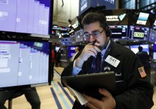 FILE - In this Jan. 27, 2020, file photo, trader Michael Capolino works on the floor of the New York Stock Exchange. Wall Street is opening sharply lower Monday, Sept. 21, 2020, led by financial stocks, after a report alleged banks were profiting from illicit dealings with disreputable people and criminal networks. (AP Photo/Richard Drew, FIle)