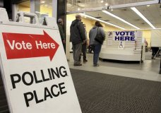 Residents in Anchorage, Alaska, take part in early voting in a mall in Alaska's largest city on Friday, Oct. 30, 2020. Alaska residents living in Juneau, Anchorage, Wasilla, Fairbanks and Nome can cast their votes early as designated locations. (AP Photo/Mark Thiessen)