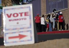 FILE - In this Nov. 3, 2020, file photo, people wait in line to vote at a polling place on Election Day in Las Vegas. The Nevada Supreme Court made Joe Biden's win in the state official on Tuesday, Nov. 24, 2020, approving the final canvass of the Nov. 3 election. (AP Photo/John Locher, File)