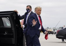 President Donald Trump arrives to board Air Force One for a day of campaign rallies, Monday, Nov. 2, 2020, in Miami. (AP Photo/Evan Vucci)
