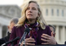 Rep. Abigail Spanberger, D-Va., speaks during a news conference with the Problem Solvers Caucus about the expected passage of the emergency COVID-19 relief bill, Monday, Dec. 21, 2020, on Capitol Hill in Washington. Congressional leaders have hashed out a massive, year-end catchall bill that combines $900 billion in COVID-19 aid with a $1.4 trillion spending bill and reams of other unfinished legislation on taxes, energy, education and health care. (AP Photo/Jacquelyn Martin)