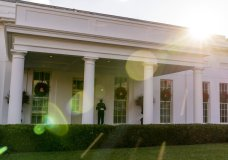 A Marine stands outside the entrance to the West Wing of the White House, signifying the President is in the Oval Office, Tuesday, Dec. 22, 2020, in Washington. (AP Photo/Andrew Harnik)