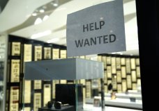 A Help Wanted sign is posted at a Designer Eyes store at Brickell City Centre, Friday, Nov. 6, 2020, in Miami. The number of people applying for unemployment aid jumped last week to 853,000, the most since September, evidence that some companies are cutting more jobs as new virus cases spiral higher. The Labor Department said Thursday, Dec. 10, that the number of applications increased from 716,000 the previous week. (AP Photo/Lynne Sladky)