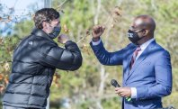 Jon Ossoff, left, and Raphael Warnock exchange elbow bumps during a campaign rally in Augusta, Ga., Monday, Jan. 4, 2021. Democrats Ossoff and Warnock are challenging incumbent Republican Senators David Perdue and Kelly Loeffler in a runoff election on Jan. 5. (Michael Holahan/The Augusta Chronicle via AP)