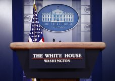 FILE - In this March 22, 2020, file photo a plaque depicting the White House is posted behind a podium in the James Brady Press Briefing Room of the White House in Washington. When Joe Biden takes the oath of office Wednesday, Jan. 20, 2021, he will begin to reshape the office of the presidency itself as he sets out to lead a bitterly divided nation grappling with a devastating pandemic and an insurrection meant to stop his ascension to power. (AP Photo/Patrick Semansky, File)