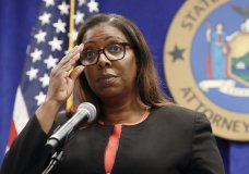 FILE - In this Aug. 6, 2020, file photo, New York State Attorney General Letitia James adjusts her glasses during a press conference in New York. New York may have undercounted COVID-19 deaths of nursing home residents by as much as 50%, the state's attorney general said in a report released Thursday, Jan. 28, 2021. James has, for months, been examining discrepancies between the number of deaths being reported by the state's Department of Health, and the number of deaths reported by the homes themselves. (AP Photo/Kathy Willens, File)