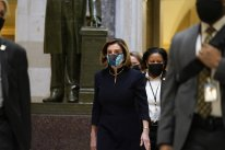 Speaker of the House Nancy Pelosi of Calif., walks through Statuary Hall on Capitol Hill in Washington, Wednesday, Jan. 13, 2021. (AP Photo/Susan Walsh)