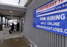 "FILE - In this Dec. 10, 2020, file photo, a ""Now Hiring"" sign hangs on the front wall of a Harbor Freight Tools store in Manchester, N.H. The latest figures for jobless claims, issued Thursday, Jan. 14, 2021 by the Labor Department, remain at levels never seen until the virus struck. (AP Photo/Charles Krupa, File)"