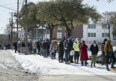 People wait in a long line to buy groceries at H-E-B on South Congress Avenue during an extreme cold snap and widespread power outage on Tuesday, Feb. 16, 2021, in Austin, Texas. (Jay Janner/Austin American-Statesman via AP)